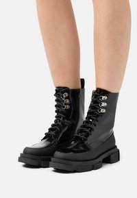 TWINSET - ANFIBIO FONDO COMBAT - Lace-up ankle boots - nero - 0