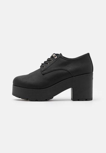 EMELINE - Lace-up heels - black