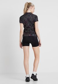 Craft - ESSENCE HOT PANTS - Punčochy - black - 2