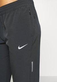 Nike Performance - SWIFT PANT - Pantalones deportivos - black/reflective silver - 5