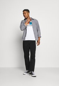 Carhartt WIP - NEWEL PANT MAITLAND - Jeans relaxed fit - black rinsed - 1