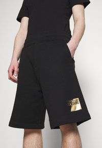 Versace Jeans Couture - Tracksuit bottoms - black - 3