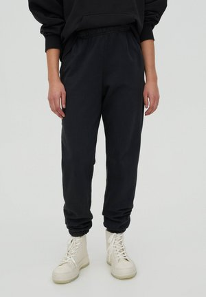 Pantaloni sportivi - mottled dark grey