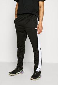 Fila - SANDRO TRACK PANT - Träningsbyxor - black-bright white - 0