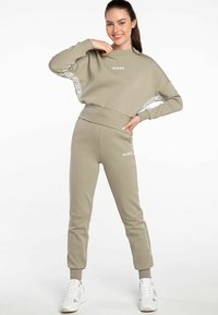 Guess - ABBY LONG  - Tracksuit bottoms - beige - 0