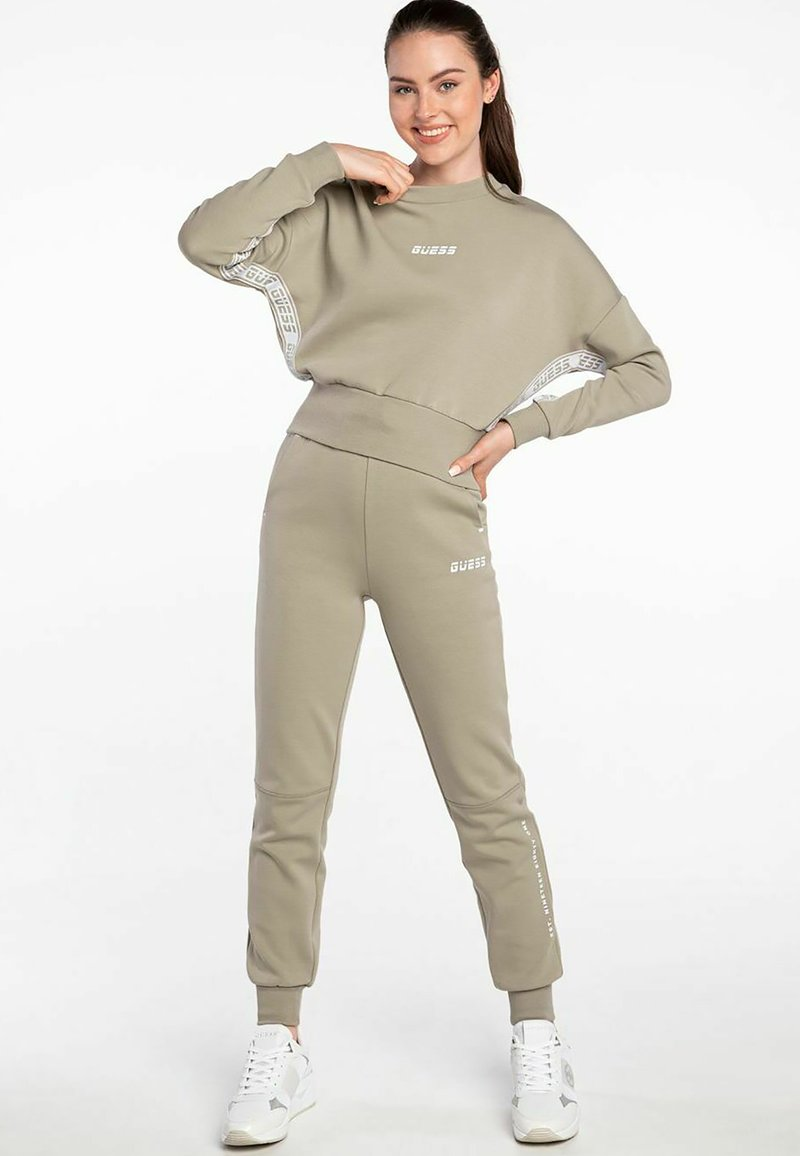Guess - ABBY LONG  - Tracksuit bottoms - beige
