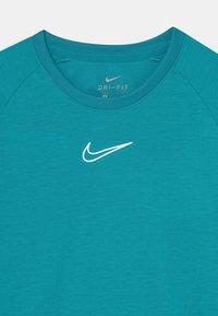 Nike Performance - UNISEX - T-Shirt print - aquamarine/white - 2