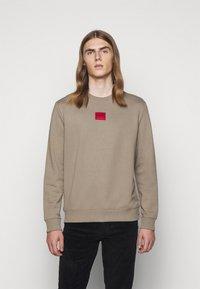HUGO - DIRAGOL - Sweatshirt - light pastel brown - 0