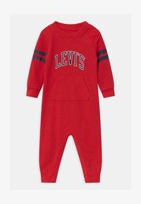Levi's® - COLLEGIATECOVERALL UNISEX - Jumpsuit - super red - 0