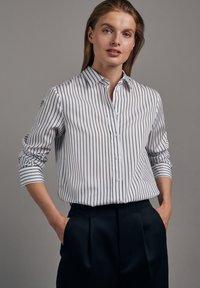 Seidensticker - SCHWARZE ROSE SLIM FIT - Button-down blouse - weiss - 4