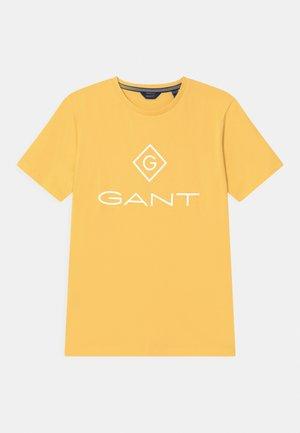 LOCK UP UNISEX - Print T-shirt - brimstone yellow