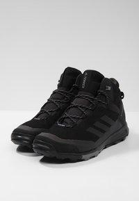 adidas Performance - TERREX TIVID MID CLIMAPROOF HIKING SHOES - Obuwie hikingowe - black - 2