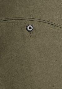 J.LINDEBERG - GRANT STRETCH PANTS - Chino kalhoty - lake green - 7