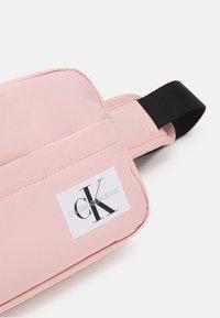 Calvin Klein Jeans - MONOGRAM BADGE WAISTBAG UNISEX - Bum bag - sand rose - 3