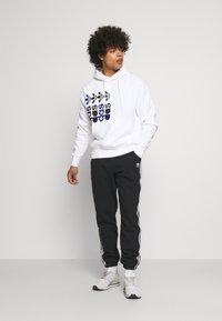 adidas Originals - NINJA PANT UNISEX - Tracksuit bottoms - black - 1