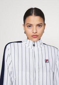 Fila - HALA TRACK JACKET - Summer jacket - blanc de blanc/black iris - 3