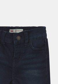 Levi's® - SKINNY PULL ON UNISEX - Slim fit jeans - dark-blue denim - 2