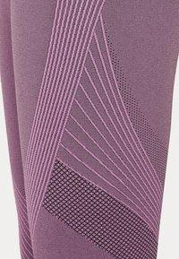 Under Armour - RUSH SEAMLESS ANKLE - Leggings - polaris purple - 7