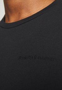 Peak Performance Urban - URBAN TEE - Basic T-shirt - black - 5