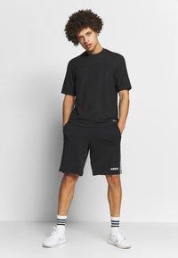adidas Performance - T-shirts basic - black - 1