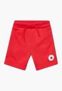 Converse - PRINTED CHUCK PATCH - Pantalon de survêtement - university red - 0