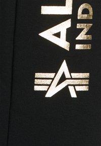 Alpha Industries - BASIC JOGGER FOIL PRINT - Verryttelyhousut - black - 2