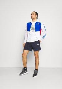 adidas Performance - Sports shorts - legink/white - 1