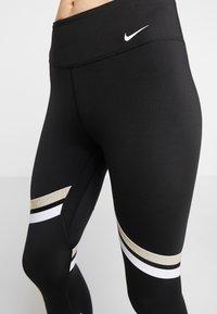 Nike Performance - ONE ICON - Legginsy - black/metallic gold/white - 3