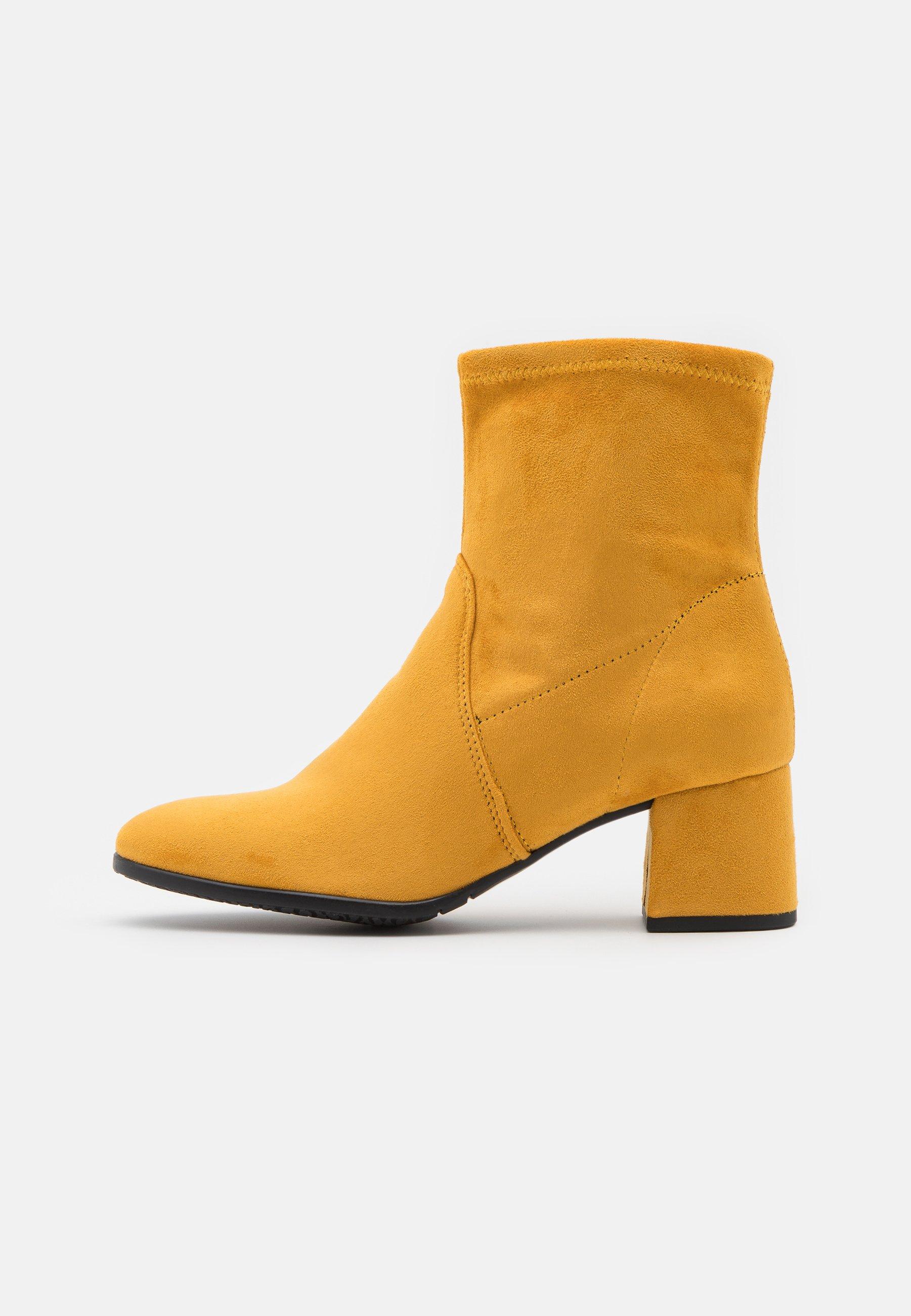 Ponadczasowe żółte botki damskie na różne okazje Odwiedź