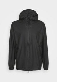 Rains - STORM BREAKER UNISEX - Vodotěsná bunda - black - 5