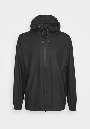 STORM BREAKER UNISEX - Waterproof jacket - black