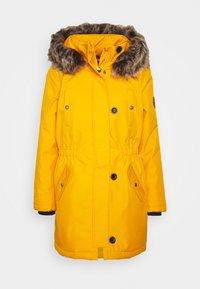 ONLIRIS - Winter coat - golden yellow