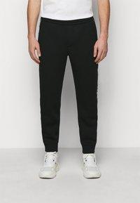 Emporio Armani - Pantaloni sportivi - black - 0