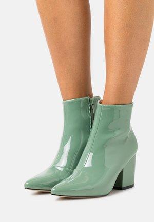 KOLA - Ankle boots - green