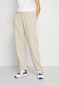 Nike Sportswear - Tracksuit bottoms - beige - 0