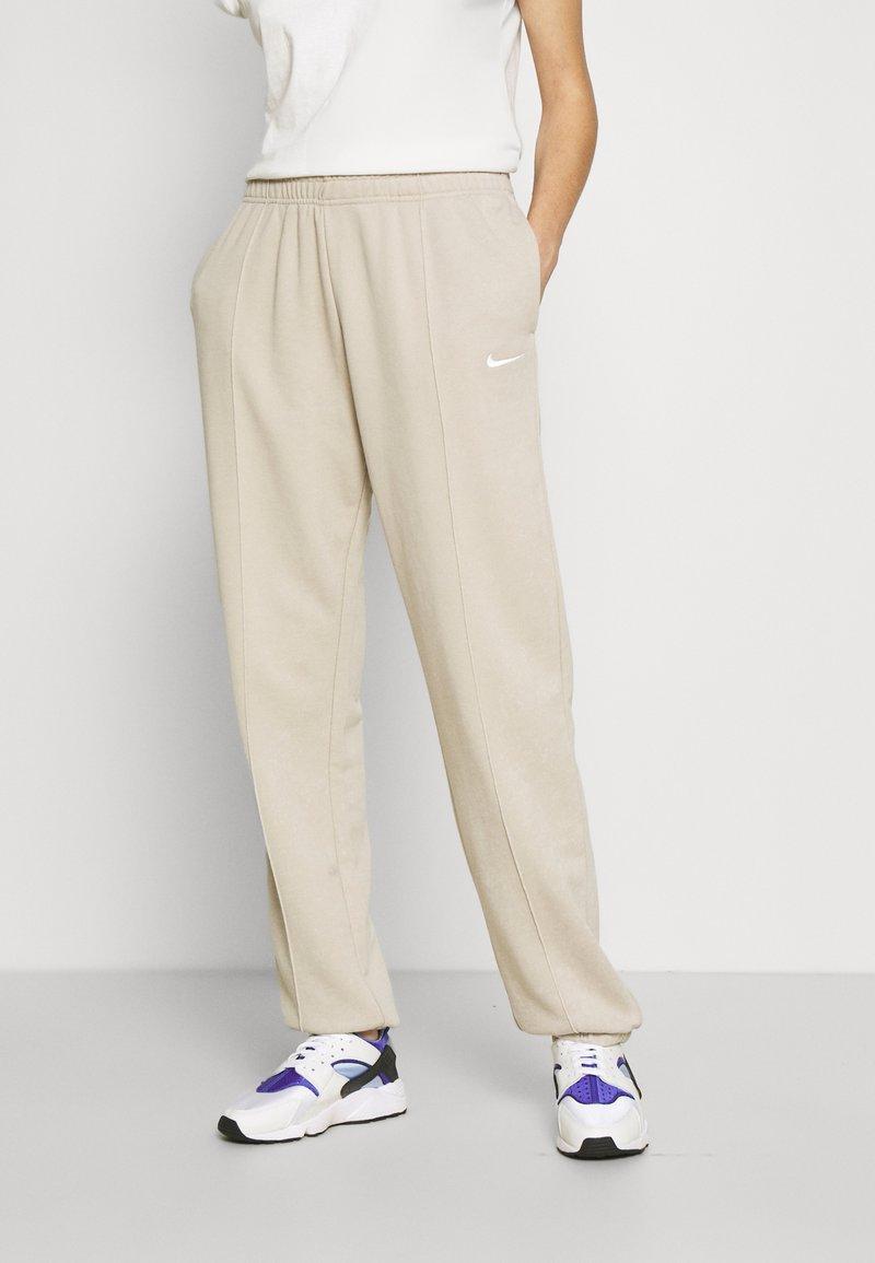 Nike Sportswear - Tracksuit bottoms - beige