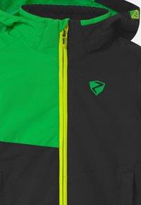 Ziener - ABIAN JUN UNISEX - Snowboardová bunda - black/green - 2