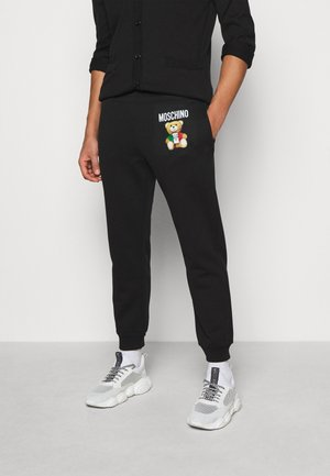 TROUSERS - Verryttelyhousut - black