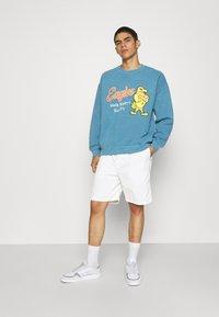 BDG Urban Outfitters - UNISEX BLUE EAGLES - Sweatshirt - blue - 1