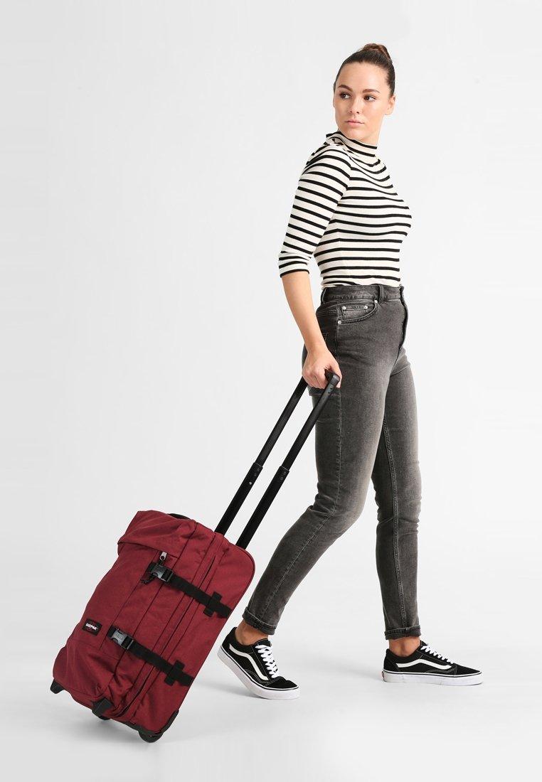 Eastpak - TRANVERZ  - Wheeled suitcase - red