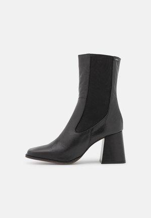 PORTYA - Kotníkové boty - black