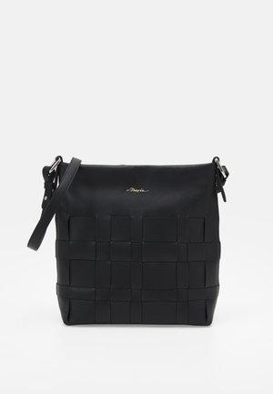ODITA SLIM SHOULDER BAG - Sac bandoulière - black