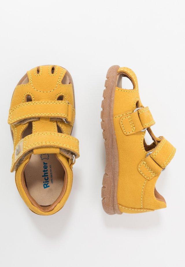 Sandaalit nilkkaremmillä - sunny