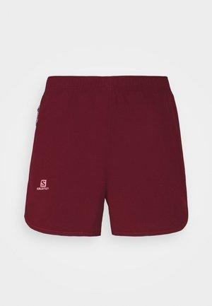 AGILE - Sports shorts - pomegranate