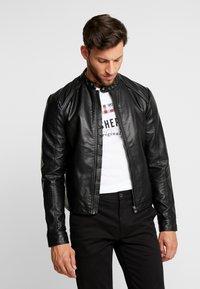 Produkt - PKTDLN DYLAN BIKER JACKET - Faux leather jacket - black - 0