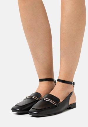 LUNA - Slippers - black