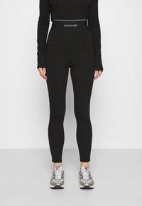 Calvin Klein Jeans - MILANO LOGO ELASTIC - Legging - black - 0