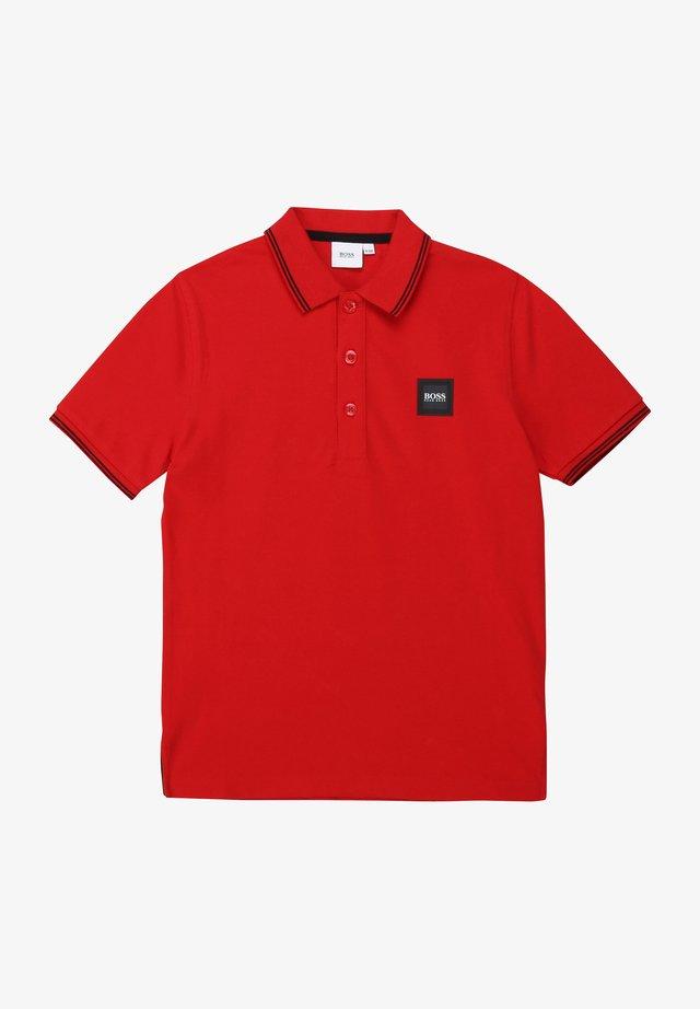 Polo - rouge ecarlate