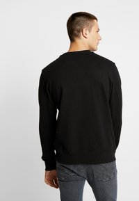Calvin Klein Jeans - TAPING THROUGH MONOGRAM - Bluza - black - 3