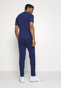 Tommy Hilfiger - CUFF PANT LOGO - Tracksuit bottoms - blue - 2